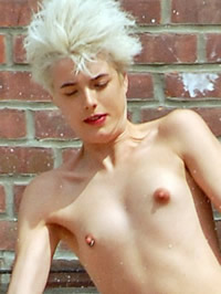 Agyness Deyn shows her shaved pussy and small tits