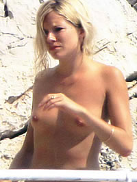 Sienna Miller caught topless on a yacht