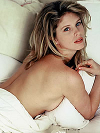 Rachel Hunter topless bed and sexy dress shots