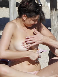 Daisy Lowe topless having fun with her friend on the beach