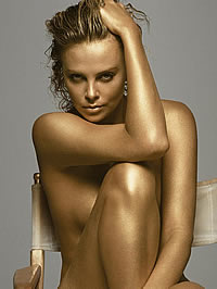 Charlize Theron posing nude and in sexy dress