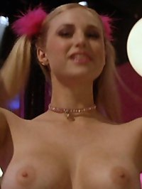 Fiona Gubelmann performs a topless lap dance in pigtails