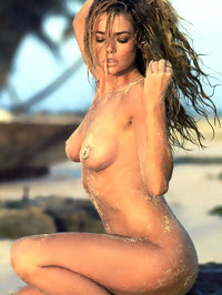Denise Richards posing fully nude on the beach