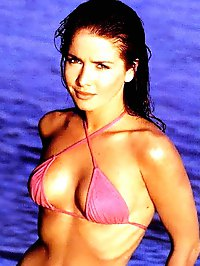 Natalia Oreiro topless and bikini shots