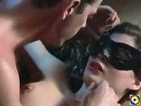 Carre Otis wearing mask in topless sex scenes