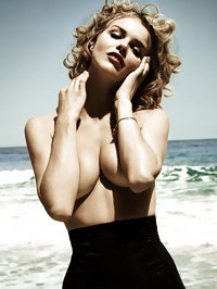 Eva Herzigova posing topless on the beach
