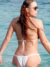 Mariah Carey wearing minimal bikini on beach