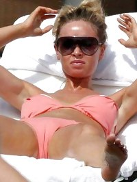 Lauren Pope sunbathing topless