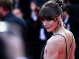 Milla Jovovich braless showing side boob in Cannes