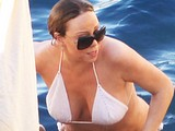 Mariah Carey showing huge cleavage in white bikini
