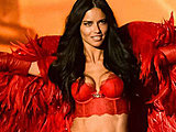 Adriana Lima shows off hot busty breasts in lingerie on the stage
