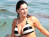 Kelly Brook sexy pinches her bare breasts