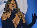 Mariah Carey flaunts her giant breasts in lowcut dress on the stage