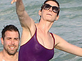 Anne Hathaway flashes all wet swimsuit breasts pokies while bathing