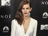 Emma Watson looks damn hot showing off her stunning cute cleavage