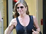 Jennifer Aniston shows her breast in black bikini