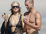 Paris Hilton caught in a tiny bikini having fun on the beach