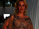 Gillian Anderson topless and see-through blouse